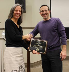 In this photo Dr. Duval, on left, is recieving a reward plaque from former Summersell Center Director and current Department Chair, Joshua Rothman.