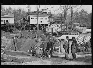 This image shows coal miners standing around in Walker County.