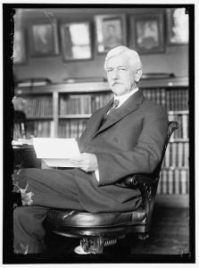 This image shows William C. Gorgas seated, reading a letter.
