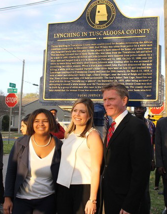 Photo of Dr. John Giggie and two Summersell Students standing near the Tuscaloosa County historical marker recounting the history of lynching in the county.